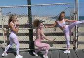 三位美女街头表演柔术,这柔韧性简直逆天了