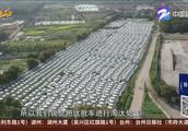 密密麻麻!  杭州钱塘江边停着五六千辆闲置电动汽车