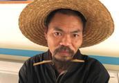 五指山寻亲:中年男子被救助,戴草帽,疑似长期流浪人员